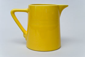 Vintage Harlequin Original Yellow 22 ounce jug or milk pitcher: Harlequin Dinnerware 30s 40s American Solid Color Dinnerware For Sale