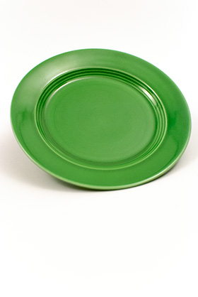 Vintage Harlequin Pottery Medium Green Bread and Butter Plate For Sale