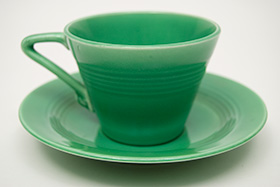 Vintage Harlequin Pottery Original Green Cup and Saucer Set For Sale