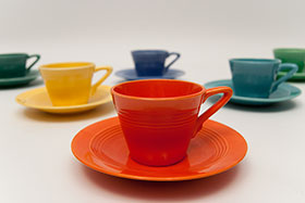 Harlequin Demitasse Cup Saucer Set Radioactive Red Original Glaze