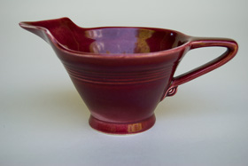 Rare Harlequin Pottery Maroon High Lip Creamer For Sale