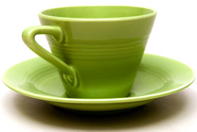 Vintage Harlequin Pottery Chartreuse Cup and Saucer Set For Sale