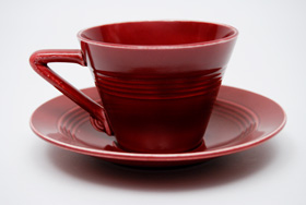 Vintage Harlequin Pottery Maroon Cup and Saucer Set For Sale