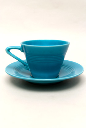 Vintage Harlequin Pottery Turquoise Cup and Saucer Set For Sale