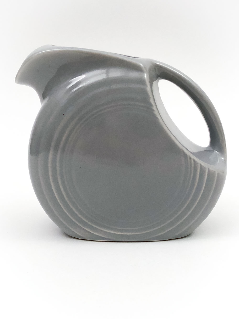 gray color small old fiesta juice pitcher